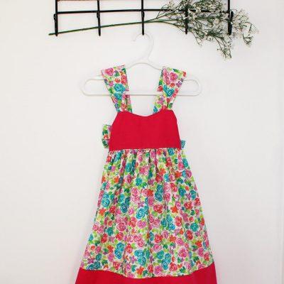 Robe ample à motifs floraux rose, bleu et vert avec grosse boucle au dos 1